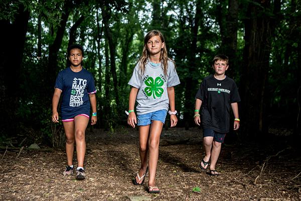 4 h members walking in the woods