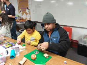 Man and child crafting at a 4-H event