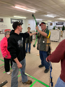 4-H shooting sports educator demonstrating proper form