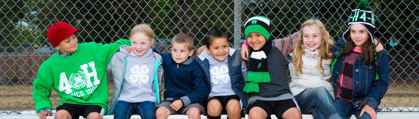cloverbud kids sitting on outdoor bleachers