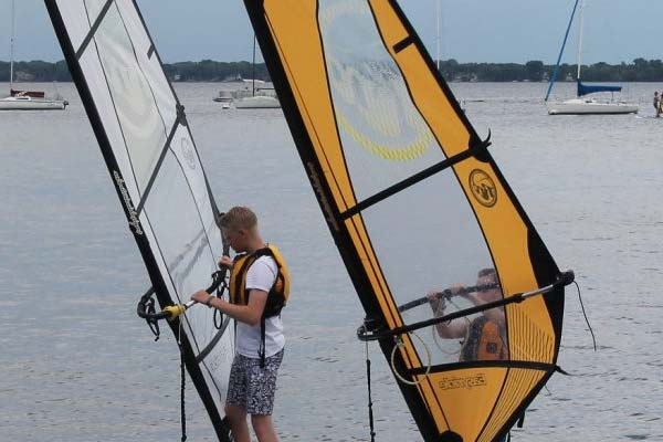 youth learning to sailboard