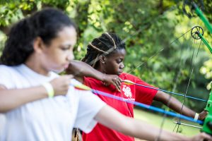 2 girls with archery bows