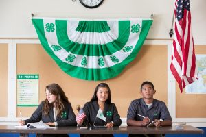 4-H club officers at table