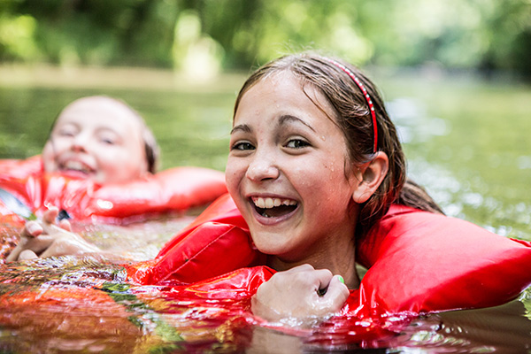 4-H members swimming in a lake